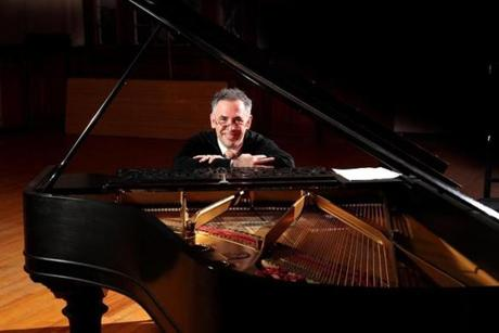 Lincoln MA 10/30/16 Robert Berkowitz, a psychiatrist and high-level amateur pianist from Natick performing the music of Lajos Delej, a promising Hungarian composer during a recital called Rhapsody in Bemis Hall on Sunday October 30, 2016. Berkowitz mother was engaged to marry Lajos Delej, before he died in Buchenwald during the Holocaust. (Photo by Matthew J. Lee/Globe staff) topic: Delej(2) reporter: Malcolm Gay